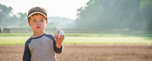 Child holding a baseball